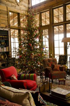 The breathtaking Amanda Brooks family Christmas tree features prominently in the windowed living room.