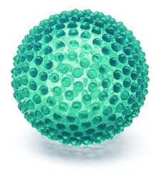 """Tangiball  Once your child wraps his hands around this ball, he won't want to put it down. With its nubby texture, crystalline brilliance and light vanilla scent, Tangiball stimulates all of the senses at once. Baby can squeeze it, squeak it, sniff it, roll it, and even kick it for gross motor development. 4"""" / 10 cm. diameter.  12 months – preschool"""