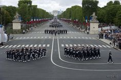 French Navy officers and sailors of the air defense frigate Chevalier Paul marching down Champs-Élysées Avenue in Paris at the 2012 Bastille Day Parade.