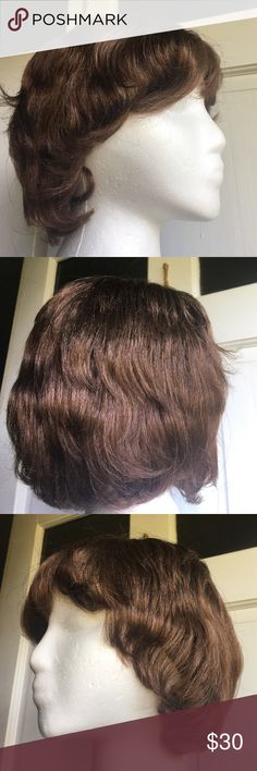 Beautiful Brown Short Wavy Wig New This is a beautiful brownish tone wig.. Very soft and very easy to wash and style.  Wavy and very stylish. Accessories Hair Accessories