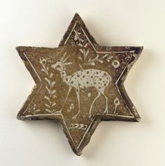 Tile  early 13th century      Saljuq period    Stone-paste painted over glaze with luster  H: 14.3 W: 12.7 cm  Iran