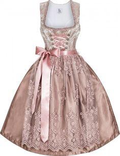 """Das Festtagsdirndl """"Tiffany"""" überzeugt durch seine noble und elegante Farbpalette in zartem Rosé uns Silber"""