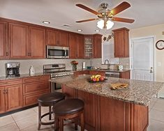 This All New Kitchen Is Designed With Classic Cherry Maintenance Free  Cabinets, Accented With