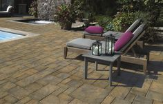 This beautiful pavingstone pool patio features the Sherwood Collection from Cambridge Pavingstones with Armortec.