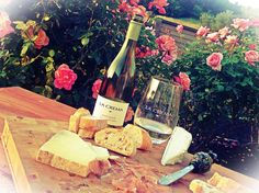 The roses from his garden smell the sweetest. What more do I desire, a loaf of bread, a bottle of wine, and you.