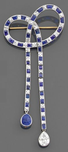 An Art Deco platinum, sapphire and diamond bow brooch, by Tiffany & Co., circa 1925. #Tiffany #ArtDeco #brooch