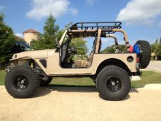 Tan TJ, love the paint job and the exoskeleton (fenders in particular)