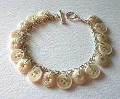Sterling silver bracelet adorned with antique cream glass buttons Mrs Gibson on Etsy.