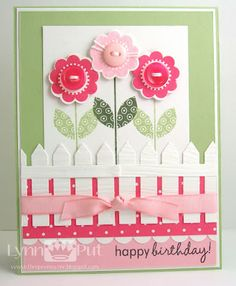 Love these sweet flowers with the picket fence. Could use stripes embossing folder for the fence and the sizzlits for the flowers and heart punch for petals.
