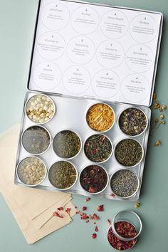 This lovely set of tea features four different green teas and a range of herbs like chamomile, tamarind, and spearmint, this twelve-container kit is ready-made for gifting to tea lovers. Spices Packaging, Tea Packaging, Tea Gift Sets, Tea Gifts, Herbal Green Tea, Tea Design, Cover Design, Design Art, Graphic Design