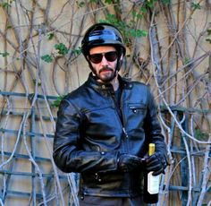 WHY DO WE LOVE KEANU? Black leather and wine. 'Nuf said. (chicfoo) keanu
