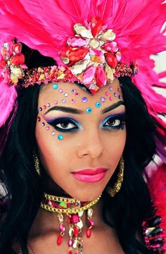 Colorful feathers and jewels accent pretty blue and purple smokey eyes.