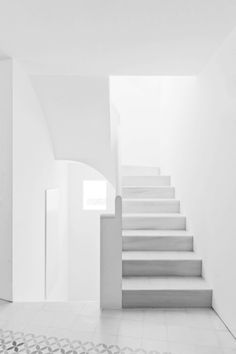 Silver blonde grey living stairway light peaceful simplistic white walls and flooring