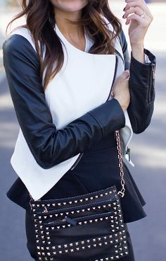 Black and white jacket and studded crossbody bag