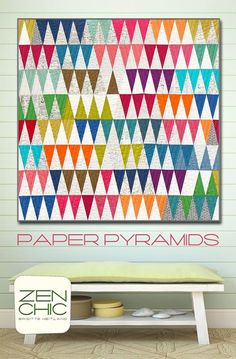 Based on the traditional thousand pyramids quilt and using my new low volume backgrounds PAPER, this pattern is called PAPER PYRAMIDS. The wonderful colors of Moda Fabrics United Notions crossweaves are the perfect companion for this quilt.