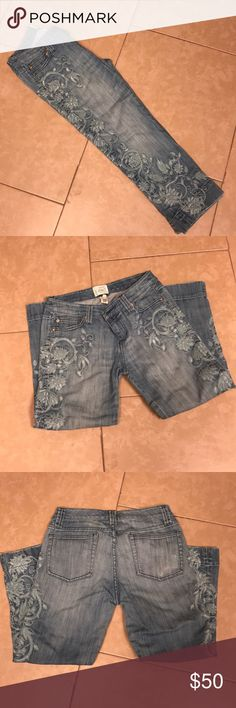 Embroidered Denim Capris These are a must have! These Denim Capris have emboridered flowers down both pant legs. In excellent condition. Size 2, fits on the big side. White House Black Market Jeans