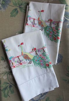Peacock embroidered pillowcases.