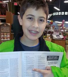 Jake points to his name and book on the New York times bestseller's list.  12 year old wrote a book through determination.