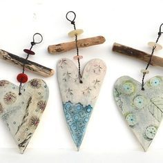 Hanging hearts: wire ceramic and a stick...