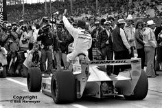 Johnny Rutherford waves to the crowd after winning the pole position for the 1980 Indianapolis 500 in Jim Hall's Chaparral 2K. Two weeks later, Rutherford also won the race.
