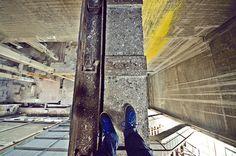 """7 stories above, I watch my feet in vertigo."""