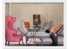 Luxe!  A hot pink Papa Bear-esque chair, gueridon table , Hermes scarf cushion and day bed...........k