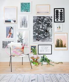 Gallery walls are bold, so think big when planning yours. Don't be afraid to go high and low with your frames, like in this example. This idea is perfect for dressing up large spaces rather than painting the walls. There are so many different ways to take a plain wall and fill it to the brim!