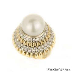 View this item and discover similar for sale at - An amazing yellow gold Wedding Cake ring by Van Cleef & Arpels from the The ring is circulated with alternating layers of pave set diamonds Van Cleef And Arpels Jewelry, Van Cleef Arpels, Used Vans, Dress Rings, Jewelry Rings, Lotus Jewelry, Jewlery, Selling Jewelry, Vintage Jewelry