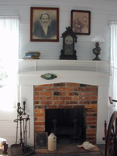 Nice farmhouse fireplace with horizontal wainscoting walls.