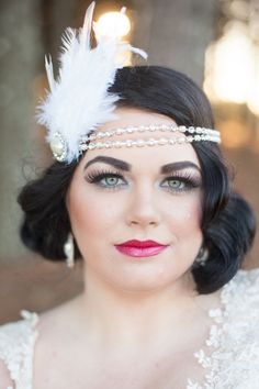 Glam bride look with finger curled hair and head piece. #weddinghair #makeup #weddingchicks Hair: Corinna Dewitt of Versa Salon Make Up: VAMP ---> http://www.weddingchicks.com/2014/04/28/wedding-ideas-with-some-va-va-voom/