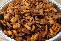 Bourbon Bacon Chex Mix Made without the Bourbon so it's kid friendly - and it's delish! didn't use pre-made chex mix - used shreddies, rice chex and pretzels that I had in the pantry. Chex Mix Recipes, Snack Recipes, Cooking Recipes, Yummy Recipes, Kentucky Derby, Bourbon, Football Food, Yummy Food, Yummy Snacks