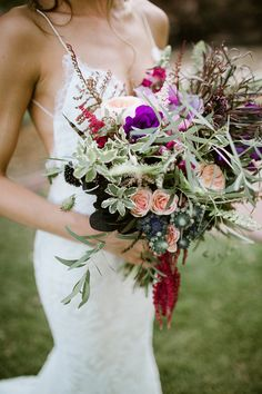 purple wedding bouquet - photo by Our Love is Loud http://ruffledblog.com/river-bend-colorado-wedding