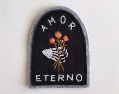 As hopeful as ever.  This patch is carefully hand cut and embroidered by hand with bold peach stitching and bright red fill detail. No two are exactly