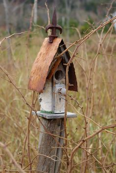 Rustic copper roofed bird house!