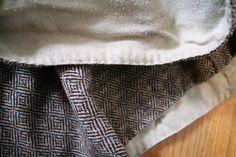 Viking hood detail, hemming the front opening. Vikingsnitt