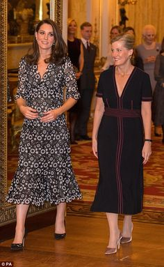 Stylish entrance: Kate and Sophie, clad in Erdem and Burberry respectively, enter the Musi...