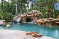 Poolandspa.com Tropical Swimming Pool with Left turn pool slide.. Weeeeeee....