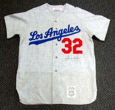 Sandy Koufax Autographed/Hand Signed Mitchell & Ness Dodgers Road Jersey PSA/DNA #O03799 by Hall of Fame Memorabilia. $1151.95. This is an authentic Mitchell & Ness jersey that has been hand signed by Sandy Koufax. It has been authenticated by PSA/DNA and comes with their sticker and matching full page certificate. The jersey is a size L.