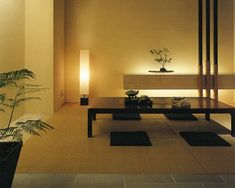 This is the perfect example of modern Japanese design. The low table, simple design, and neutral colors are all part of this style. As well, having the low light with the plants really sets a cool aura. Modern Japanese Interior, Modern Japanese Architecture, Japanese Style House, Asian Interior Design, Japanese Furniture, Japanese Interior Design, Japanese Home Decor, Japanese Modern, Interior Design Living Room