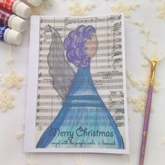 Merry Christmas Purple Curls Angel Greetings Card. Perfect for mothers, daughters, family & friends. Angelic gift for Christmas. Angel Decor