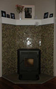Custom Made Fireplace Corner Pellet Stove. This is what I'm thinking of for our pellet stove surround (wall angles, tile), but with lighter tile colour, a full mantle, centred in the room
