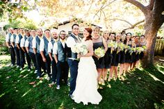 large bridal party pose, yellow and gray bridal party colors, rustic wedding
