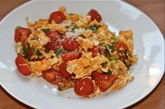 Scrambled eggs with cherry tomatoes and spring onion.