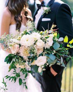 Melissa Broadwell of Vintage Florals created the bridal bouquet, which included dahlias, Sahara roses, Queen Anne's lace, ranunculus, astrantia, lisianthus, tuberose, jasmine, eucalyptus, pittosporum, and Jackson vine.