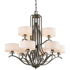 This 9 light, 2 tier chandelier from the Leighton Collection is the epitome of elegant, enduring design. This distinctive style radiates a classic feel with its inviting Olde Bronze® Finish and soft, sweeping curves. Yet what really takes center stage is the polished K9 Optical Crystal Accents and pendant-style shades that give it a contemporary edge