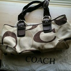 AUTHENTIC COACH PURSE! Authentic Coach Tonal Chocolate Signature zip purse. #12195.  2 Handel's with silver hardwear. Top zip closure, hang tag, interior IP pocket and dust bag. Minor mark as seen in pic 4. Coach Bags