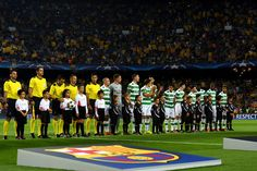 Celtic players look on prior to the UEFA Champions League Group C match between FC Barcelona and Celtic FC at Camp Nou on September 13, 2016 in Barcelona, Catalonia.