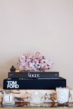 coffee table styled with decor books and accessories. / sfgirlbybay