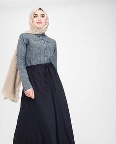 Say 'hello classy casual' with this denim chambray with a flared skirt Jilbab, featuring a belt feature and utility pockets! This is your ultimate campus casual to look effortlessly chic.