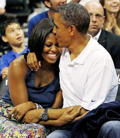 12 Best Celebrity Kisses of 2012: Barack and Michelle Obama.